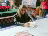 Susan Zeidler signing at an event